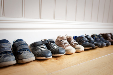 housing lot: Row of little boys shoes