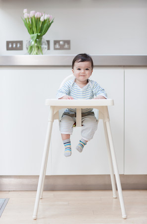 0 1 years: Baby boy in his high chair