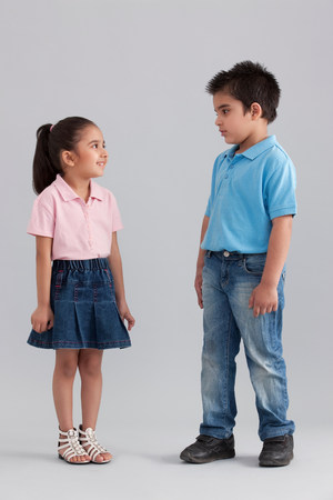 indian subcontinent ethnicity: Brother and sister looking at each other