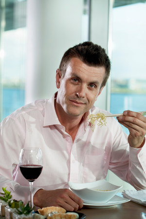 30 years old man: Businessman eating noodles,portrait