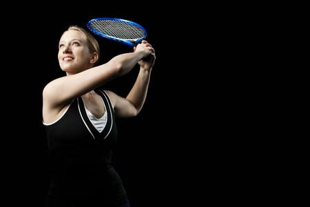 exerting: Tennis player holding tennis racket