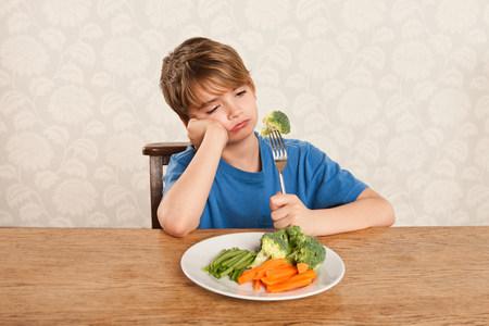 fedup: Boy frowning at vegetables LANG_EVOIMAGES