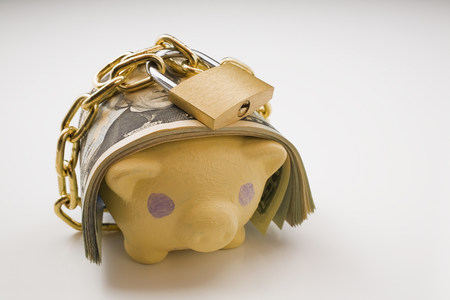 inaccessible: Piggy bank with bank notes and padlock LANG_EVOIMAGES