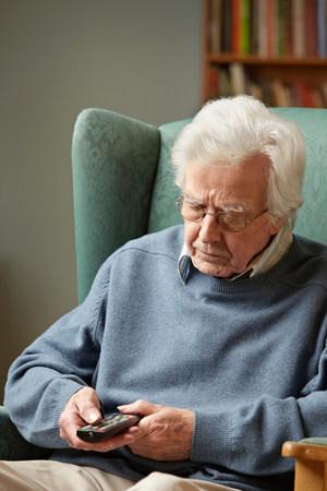 remote controls: Senior man using remote control