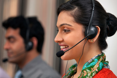 indian subcontinent ethnicity: Female call center agent smiling