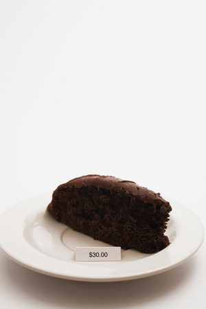 Slice of chocolate cake with 30 dollar price tag