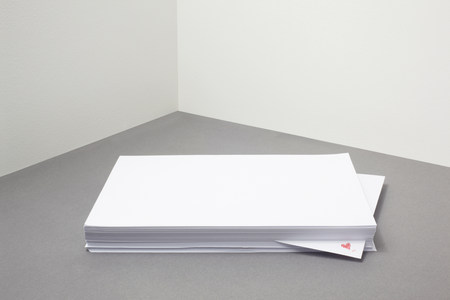 Stack of blank paper with heart shape on one piece