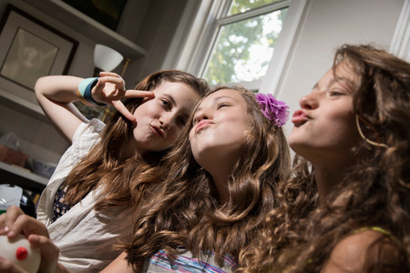 puckered: Three girls pulling faces