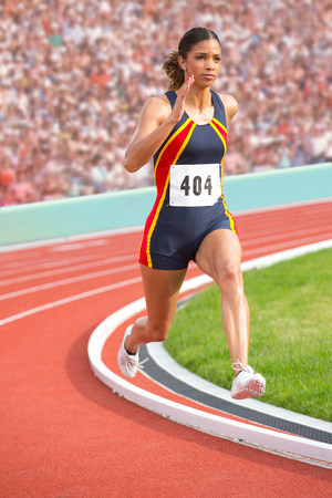 athleticism: Female athlete running on track LANG_EVOIMAGES