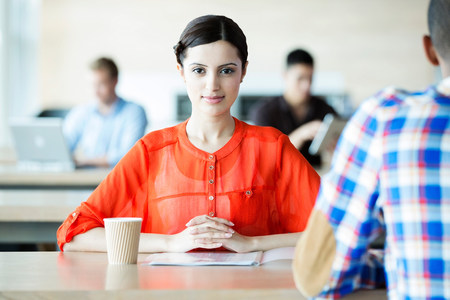 cup four: Young woman in break room LANG_EVOIMAGES