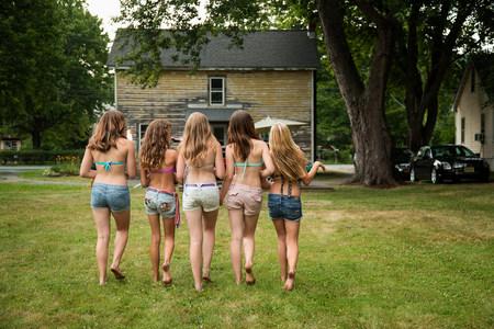 Five girls wearing bikini tops and shorts,rear view