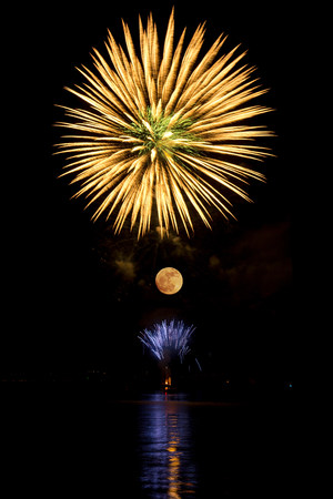 Firework in the sky above the moon LANG_EVOIMAGES