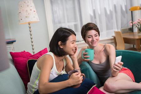 tea breaks: Young women looking at smartphone