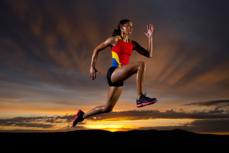 athleticism: Athlete in mid air against sunset