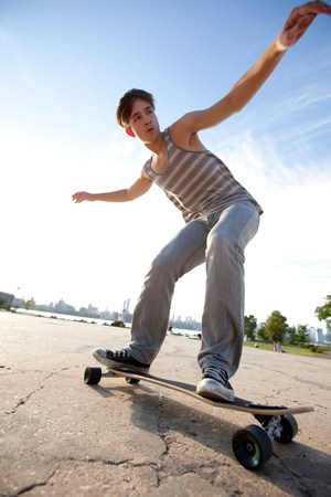 low section: Young man skateboarding LANG_EVOIMAGES