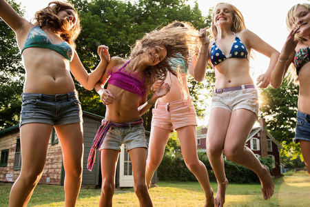 Girls dancing in garden