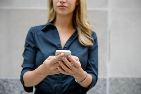 Businesswoman reading email on smartphone