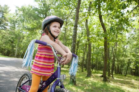 stripy: Girl leaning on bicycle handlebars