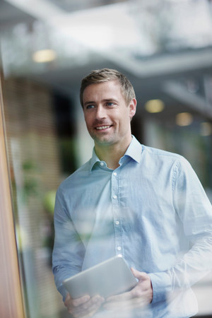 Mid adult businessman holding digital tablet,portrait