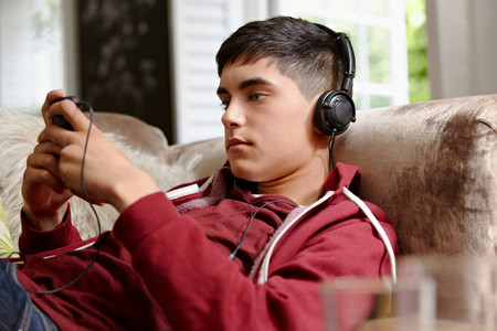indian subcontinent ethnicity: Teenage boy listening to music