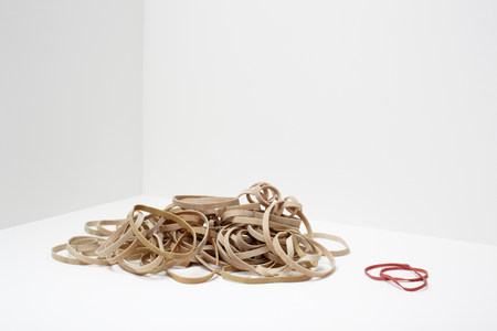 Stack of rubber bands with two red rubber bands