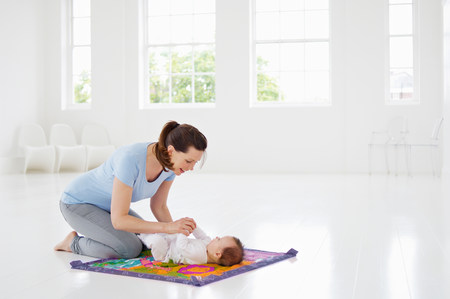 casual clothing 12 year old: Mother and baby on play mat LANG_EVOIMAGES