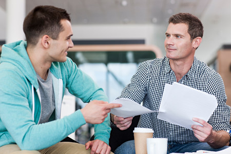 two persons only: Man giving colleague document