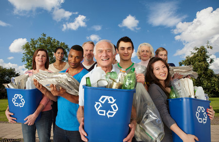 Group of people with recycling in bins LANG_EVOIMAGES
