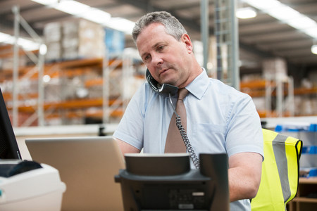 one mature man only: Warehouse manager on the phone