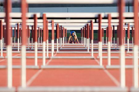 athleticism: Male hurdler at starting line LANG_EVOIMAGES