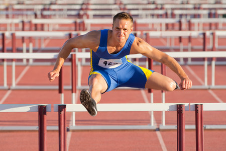 gifted: Male hurdler clearing hurdles LANG_EVOIMAGES