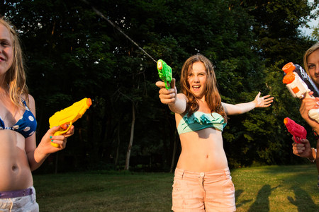 impulsive: Girls having water fight with water pistols