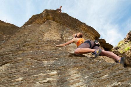 Rock climbers scaling rock,Ruapuke,Raglan,New Zealand LANG_EVOIMAGES