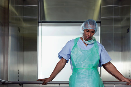 surgical gown: Portrait of surgeon in hospital elevator