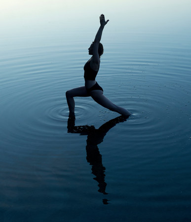 wa: Woman in yoga pose in lake