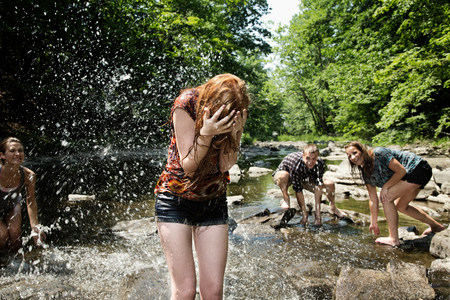 jesting: Friends playing in river LANG_EVOIMAGES