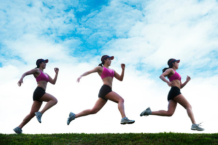 Composite multiple image of young woman running LANG_EVOIMAGES