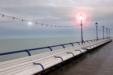water feature: Empty benches on seaside pier,Eastbourne,East Sussex,UK LANG_EVOIMAGES