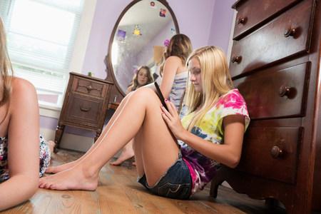 engrossed: Girl sitting on bedroom floor with digital tablet