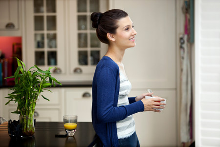 sweatshirts: Young woman eating breakfast