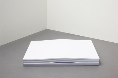Stack of paper with something inside