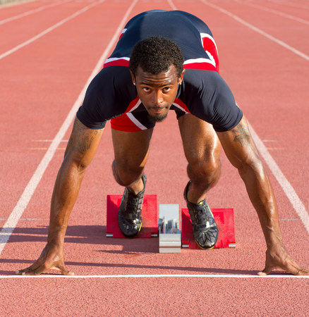 Athlete on starting blocks