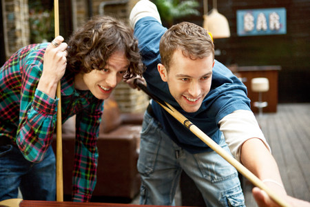 18 20 years: Two friends playing pool in bar