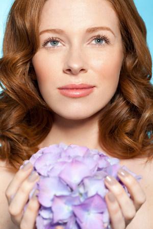 purples: Woman holding purple flowers