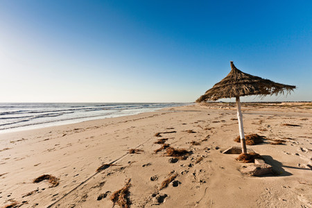 travel features: Parasol on beach on island of Djerba,Tunisia LANG_EVOIMAGES
