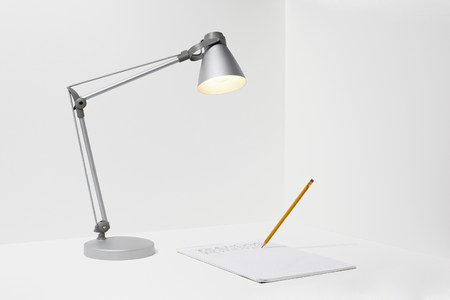 three cornered: Lamp,pencil and paper