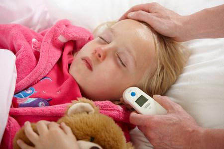 Parent taking daughters temperature