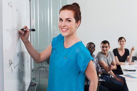 information age: Woman drawing graph on whiteboard LANG_EVOIMAGES
