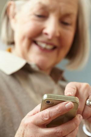 silver surfer: Senior woman using smartphone