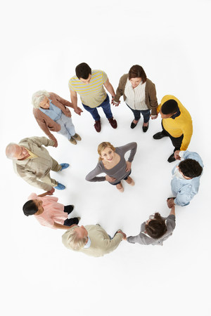 Group of people in a circle with woman in the middle,high angle view LANG_EVOIMAGES